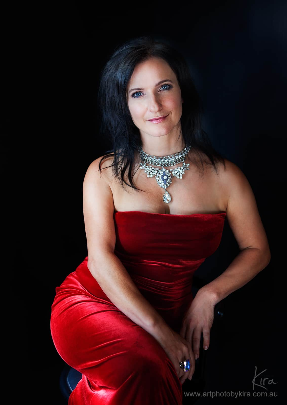 glamour shot of the woman in the red dress