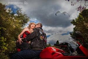 couples portrait photography red motorcycle