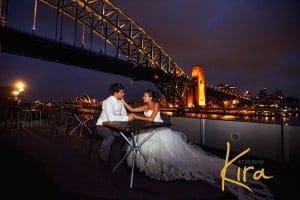 Bride and groom at sunset on Starship with a view of Opera House and Harbour Bridge
